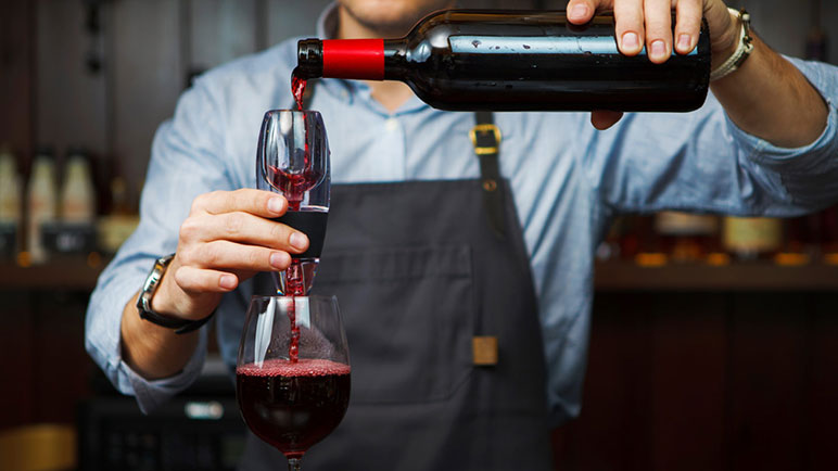 Pouring red wine through an aerator