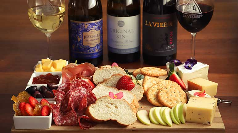 Cheese platter with three La Vierge wines